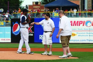 Nick delivers the game ball to the Mud Hens starter